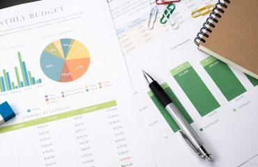 Business and financial report with pen.