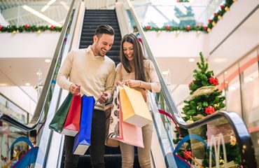 Happy couple shopping for Christmas