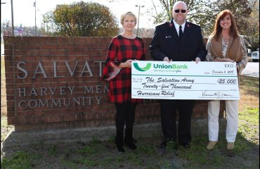 Members of Union Bank present check to Salvation Army