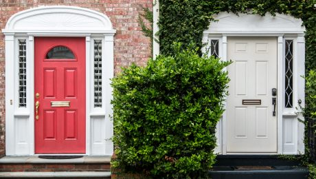 homes with red door and white door